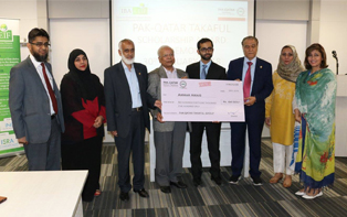 Mr Said Gul, Managing Director, Pak Qatar Takaful Group presenting full scholarship cheque to Mr. Ammar Awais, outstanding student of MS Islamic Banking and Finance